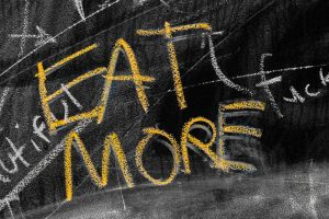 picture saying 'eat more' which is an example of a typical unhelpful thought which cbt for weight loss in manchester can help with