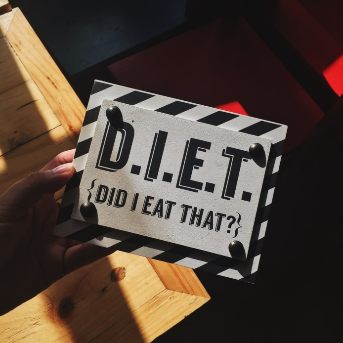 picture of a sign saying 'D.I.E.T. did I eat that?' which is what cbt for weight loss in Manchester can help with ie managing cravings