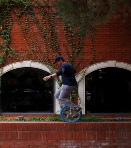 Man on unicycle as metaphor for how holistic health in Manchester can help restore equilibrium