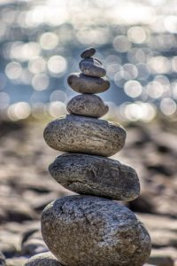 Pebbles balanced on top of each other as a metaphor for what holistic health in Manchester can offer